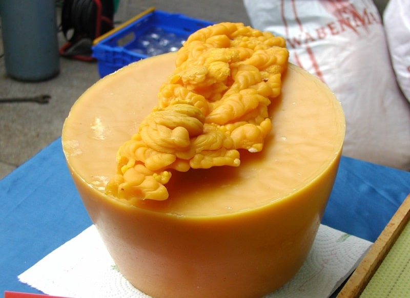 How is beeswax collected